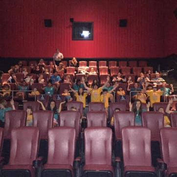 Camp COAST members pose at the movie theatre