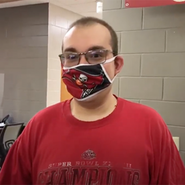 MASH program participant wearing Bucs face covering and red shirt
